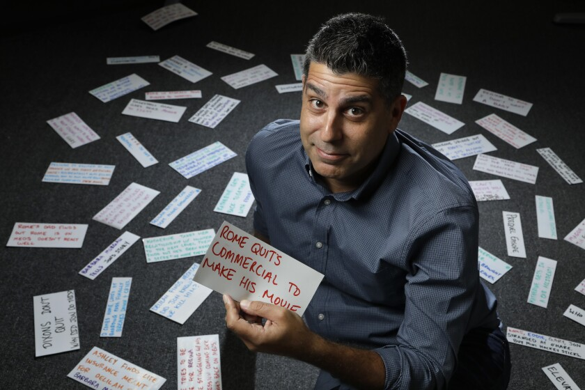 """""""A Million Little Things"""" showrunner DJ Nash surrounded by notes for the show."""