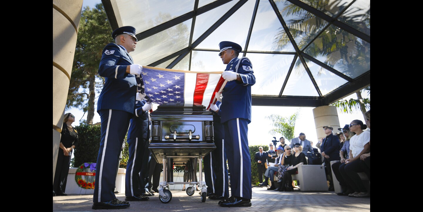 Members of the March Air Force Base Honor Guard hold an American flag over the coffin of retired Air Force Captain Claude A. Rowe, Jr., a member of the famed World War II Tuskeege Airmen during his funeral service at Fort Rosecrans National Cemetery. Rowe, who died on September 20th, was 97-years-old and the only member of the group to have flown for both the Royal Canadian Air Force and the Army Air Corps/U.S Air Force.