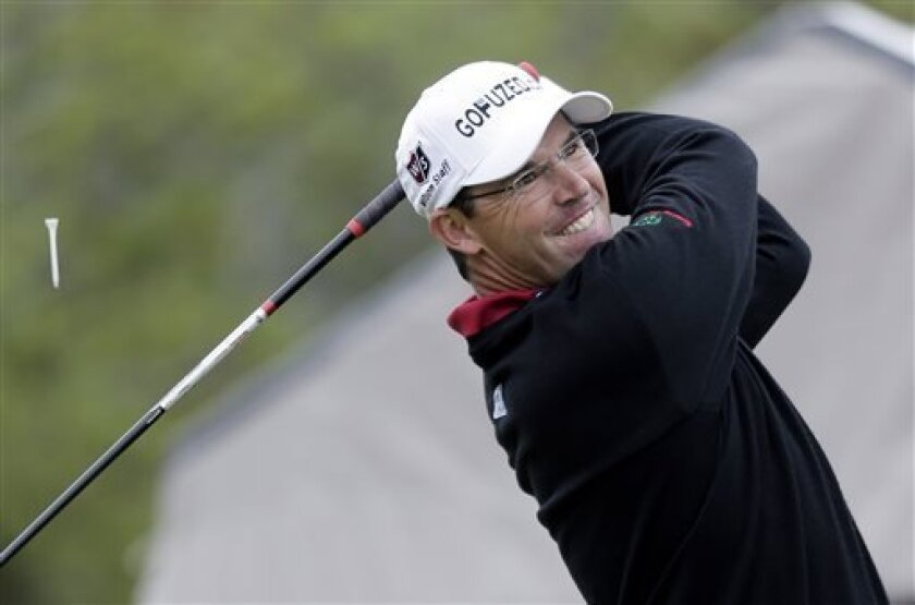 Padraig Harrington, of Ireland, hits his tee shot on the first hole during the final round of the Texas Open golf tournament on Sunday, April 7, 2013, in San Antonio. (AP Photo/Eric Gay)