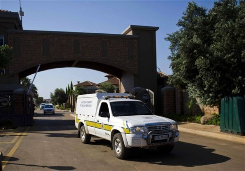 A forensics van leaves the housing estate where Olympian Oscar Pistorius lives, in Pretoria, South Africa, Thursday, Feb. 14, 2013. Reports say that a 30-year-old woman was shot dead at Pistorius's home earlier after being mistaken for an intruder. (AP Photo)