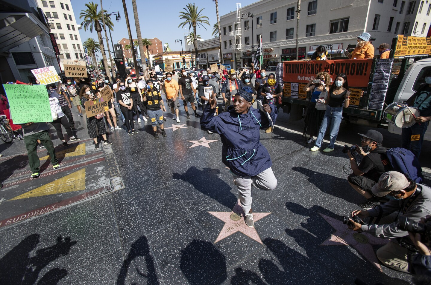 A protester dances on top of Donald Trump's star on the Hollywood Walk of Fame during a demonstration in June.