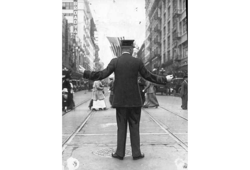 """Los Angeles Police Officer F.M. Wilson, shown at 5th Street and Broadway in 1915, was hailed as one of the first """"human semaphores"""" who ushered in a new way of directing traffic in downtown Los Angeles."""