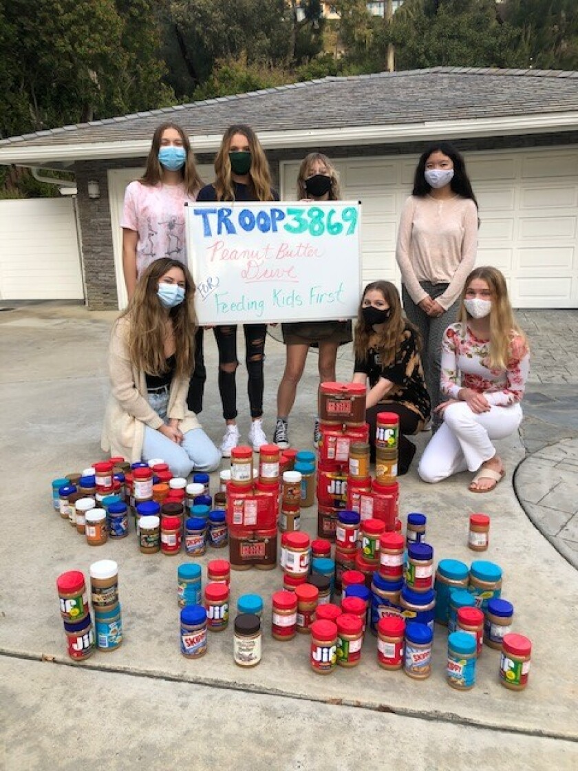 La Jolla-based Girl Scout Troop 3869 collected 130 jars of peanut butter during a food drive.