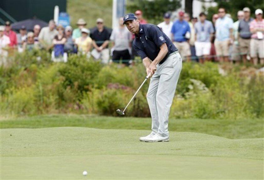Matt Kuchar watches his putt on the 18th green during the second round of the Deutsche Bank Championship golf tournament in Norton, Mass., Saturday, Aug. 31, 2013. (AP Photo/Stew Milne)