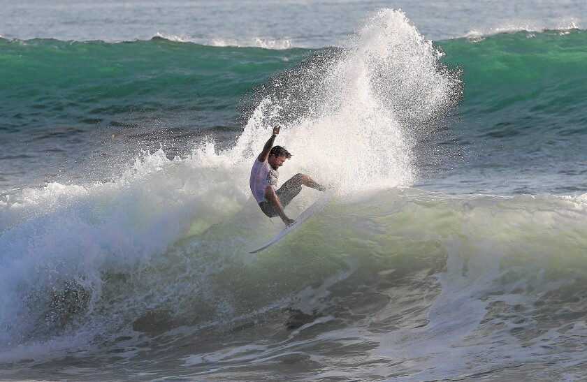 Tyler Stanaland leans into a turn as he competes in the Pro/Am final of the during the 52nd annual Brooks St. Classic surf contest on Sunday.