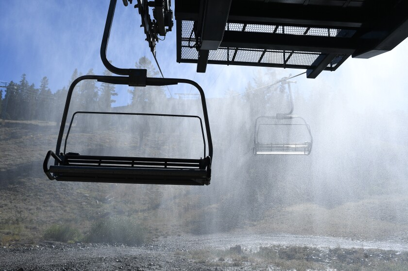 Ski lift chairs enshrouded in mist