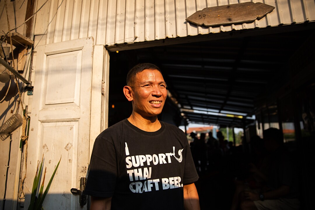 Wichit Saiklao stands at the entrance to Chit Beer, his brewhouse on Koh Kret island, Thailand.
