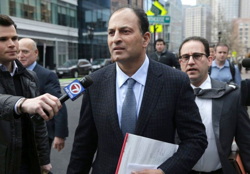 David Sidoo leaves federal court in Boston after a March 2019 hearing.
