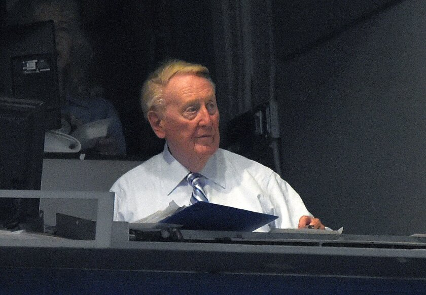 Los Angeles Dodgers Hall of Fame announcer Vin Scully sits in his booth during the third inning of a baseball game between the Dodgers and the Chicago Cubs, Friday, Aug. 28, 2015, in Los Angeles. (AP Photo/Mark J. Terrill)