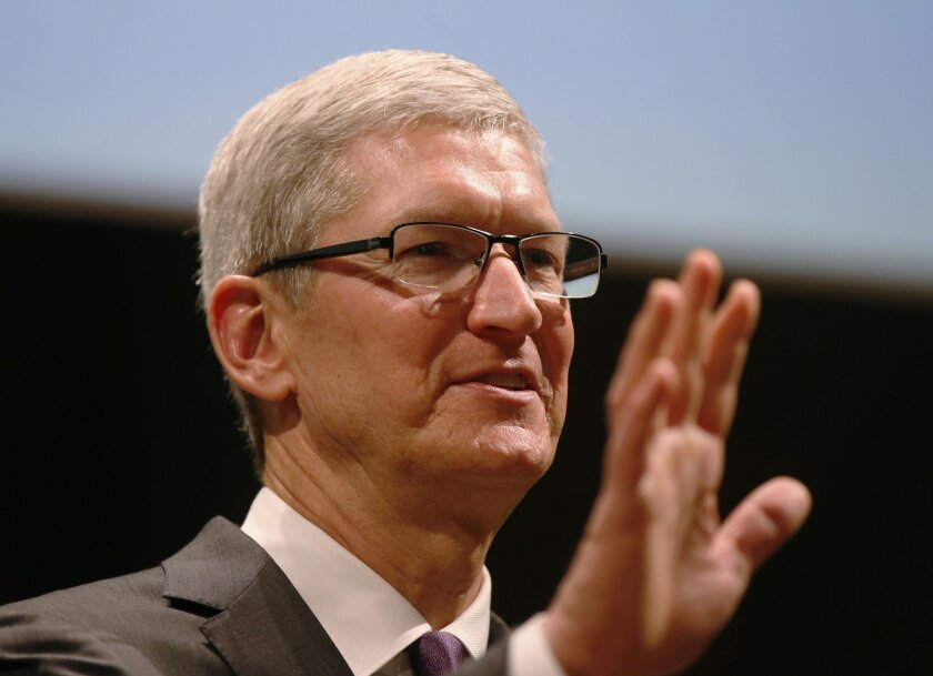 In this photo taken Nov. 15, 2015, Apple CEO Tim Cook speaks in Milan, Italy. A U.S. magistrate judge has ordered Apple to help the FBI break into a work-issued iPhone used by one of the two gunmen in the mass shooting in San Bernardino, California, a significant legal victory for the Justice Depar