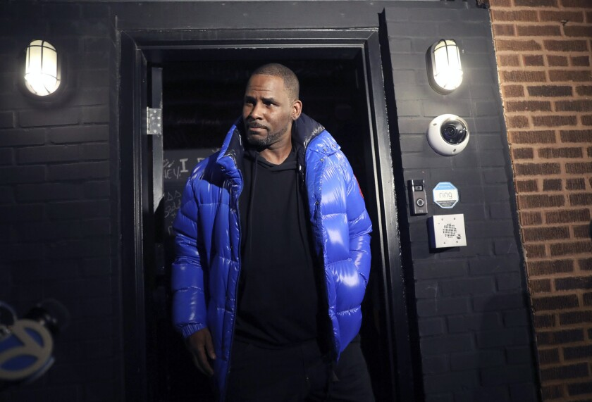 Musician R. Kelly emerges from his Chicago studio Friday night, Feb. 22, 2019. R&B star R. Kelly arr
