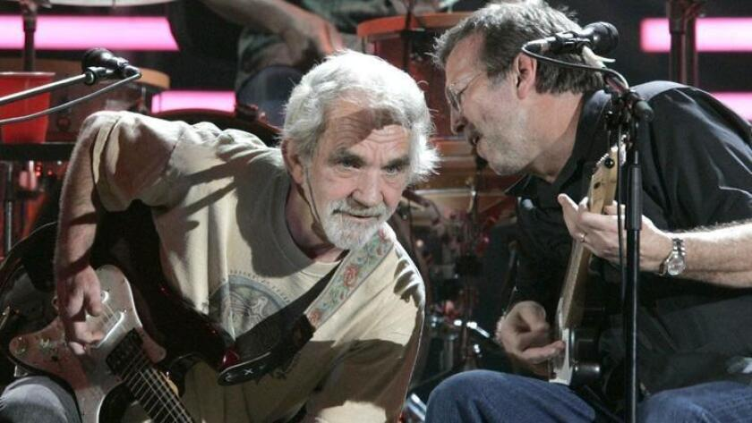 Spotlight-shunning troubadour JJ Cale (left) shared the stage with longtime fan Eric Clapton at the San Diego Sports Arena on March 15, 2007.