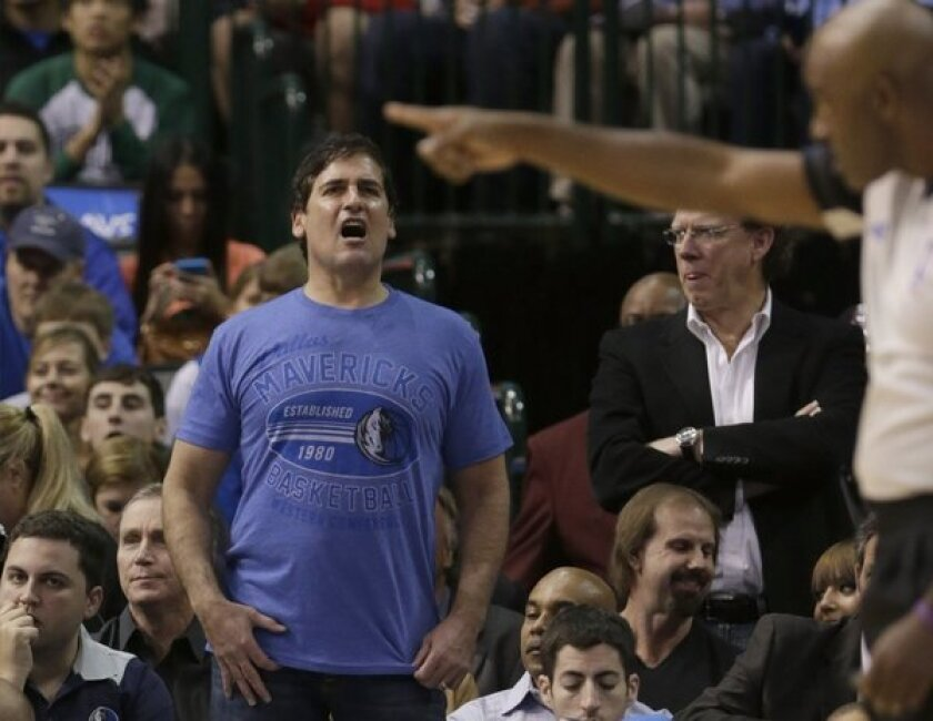 Mavericks owner Mark Cuban lets a referee know how he feels during a game.