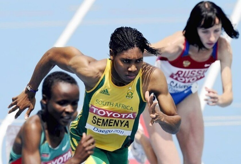 South Africa's Caster Semenya, center, was singled out for gender testing at the 2009 World Championships in Athletics in Berlin, in part because of her masculine face and build. She eventually was cleared to compete.