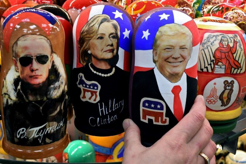 "Traditional Russian ""nesting"" dolls depict Vladimir Putin, Hillary Clinton and Donald Trump. The world looks nervously at Trump's foreign policy."