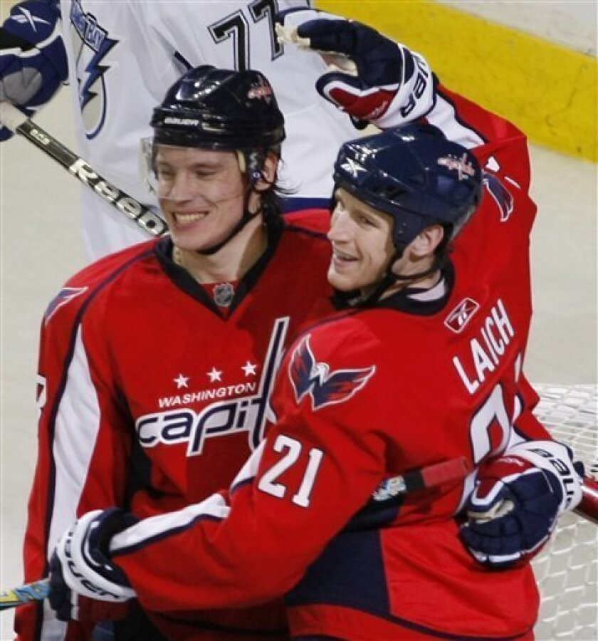 Washington Capitals' Brooks Laich (21) celebrates with teammate Alexander Semin, of Russia, after scoring a goal against the Tampa Bay Lightning during the second period of an NHL hockey game Sunday, Jan. 31, 2010, in Washington. (AP Photo/Luis M. Alvarez)