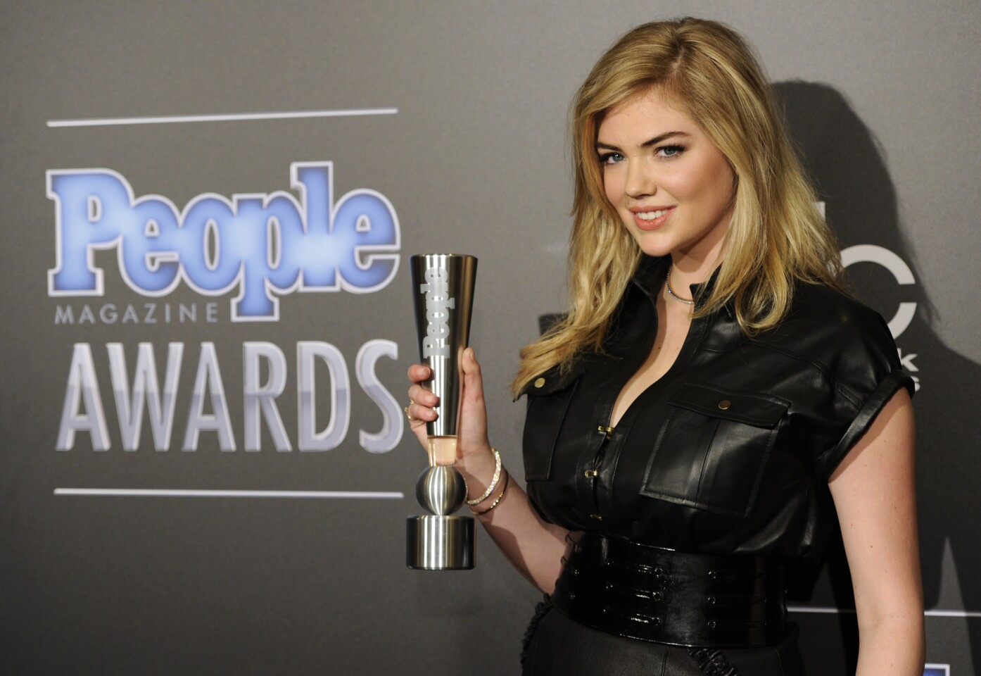 Kate Upton poses with the award for Sexiest Woman at the People Magazine Awards in Beverly Hills on Dec. 18.