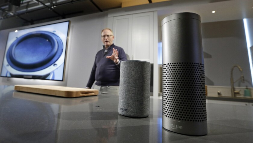 Amazon executive David Limp with an Echo and Echo Plus