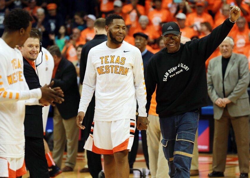 David Lattin, front right, a member of the UTEP 1966 NCAA championship team, is introduced along with present player Terry Winn during a ceremony before an NCAA college basketball game against Western Kentucky, Saturday, Feb. 6, 2016, in El Paso, Texas. (VIctor Calzada/The El Paso Times via AP) EL