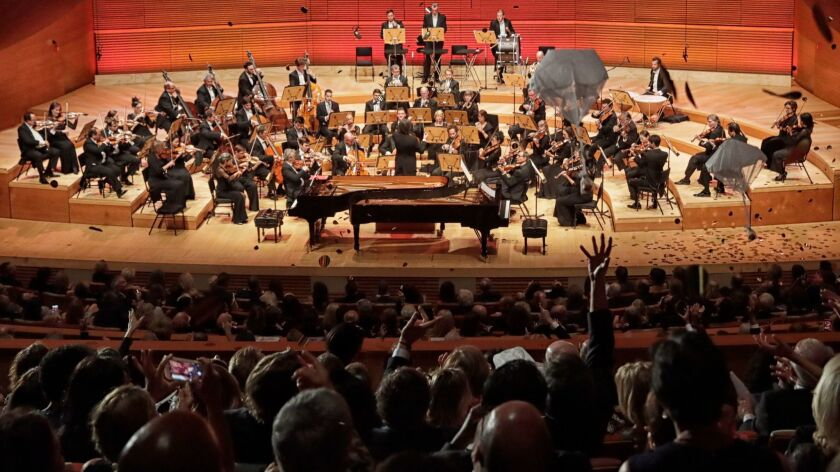 Confetti and the chocolate-and-marzipan Mozartkugeln rain onto the Walt Disney Concert Hall audience