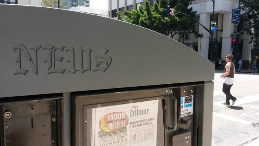 A Downtown San Diego newsrack featuring The San Diego Union-Tribune.