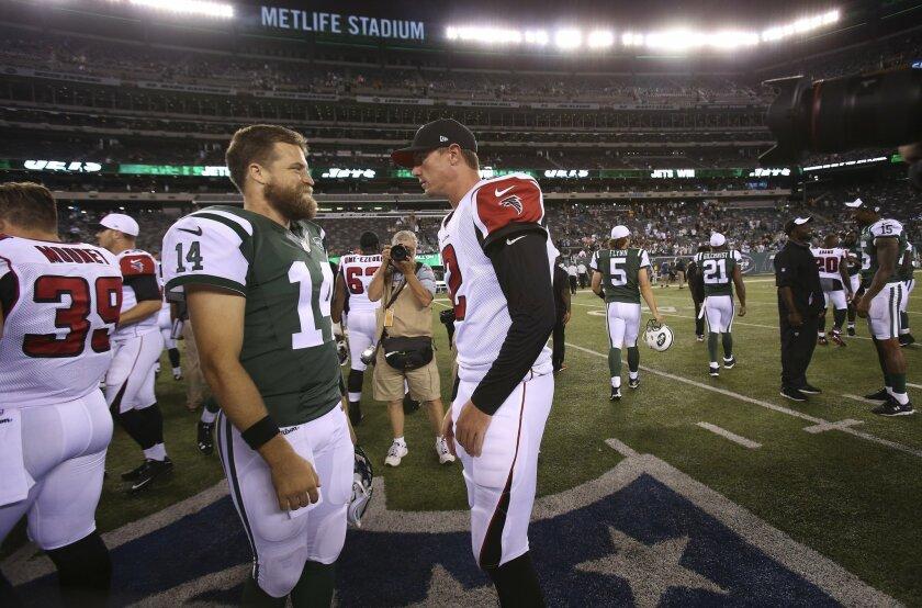 New York Jets quarterback Ryan Fitzpatrick (14) and quarterback Matt Ryan (2) talk after a preseason NFL football game Friday, Aug. 21, 2015, in East Rutherford, N.J. The Jets won 30-22. (AP Photo/Adam Hunger)