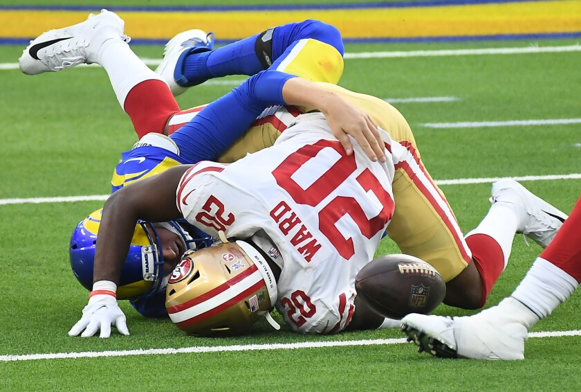 Rams quarterback Jared Goff fumbles as he is tackled by 49ers defensive back Jimmie Ward.