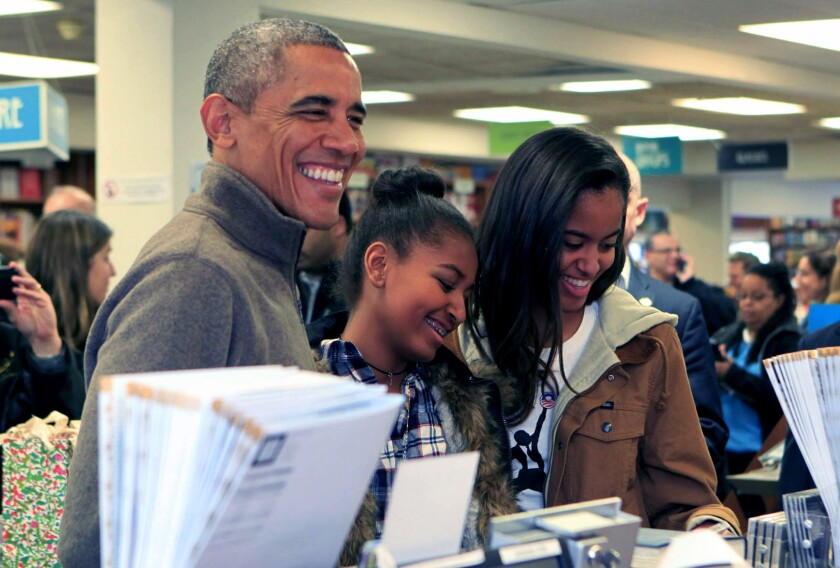 President Obama and daughters Sasha, center, and Malia at a Washington bookstore in 2014.