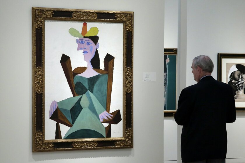"""Pablo Picasso's """"Woman Seated on a Chair,"""" a portrait of the artist's lover and muse Dora Maar, painted in 1938, estimated at $25 million to $35 million, is displayed at Sotheby's in New York, Friday, Oct. 30, 2015. Sotheby's opens the fall art auction season on Wednesday with outstanding works fro"""