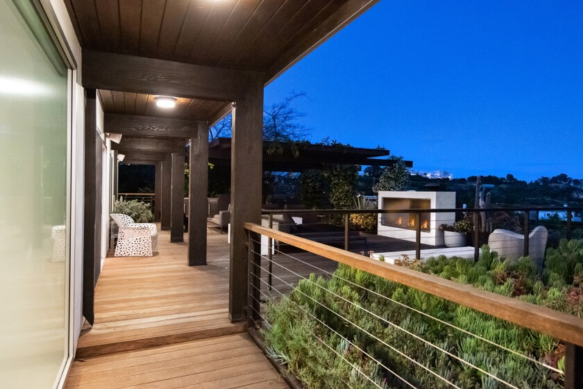 Two levels of decking take in city to ocean views.