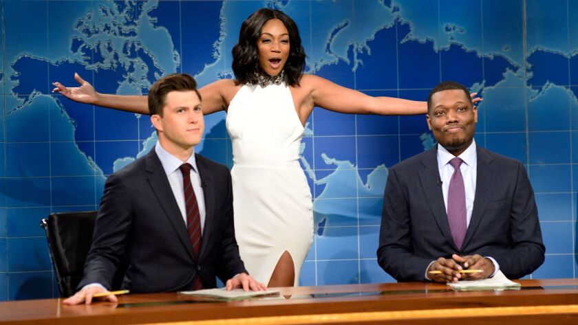 In this Nov. 11, 2017 photo released by NBC, comedian and actress Tiffany Haddish, center, appears w