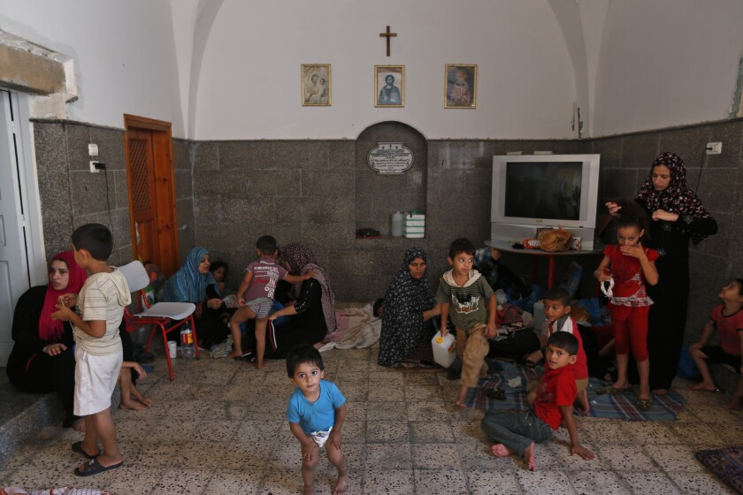Palestinians seek refuge on July 23 inside St. Porphyrios Church in Gaza City. Entire families are sleeping on thin sheets on the hard church floors.