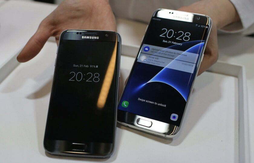 Samsung Galaxy S7, left, and S7 Edge are displayed during the Samsung Galaxy Unpacked 2016 event on at this week's Mobile World Congress wireless show, in Barcelona, Spain.