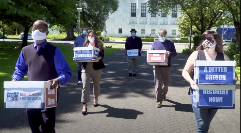 Volunteers deliver boxes containing signed petitions in favor of the measure