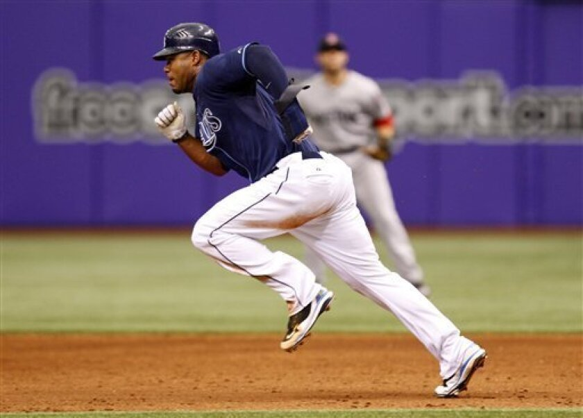 Tampa Bay Rays' Carl Crawford takes off for a steal of second base during the fourth inning of a baseball game against the Boston Red Sox Sunday, May 3, 2009, in St. Petersburg, Fla. (AP Photo/Mike Carlson)