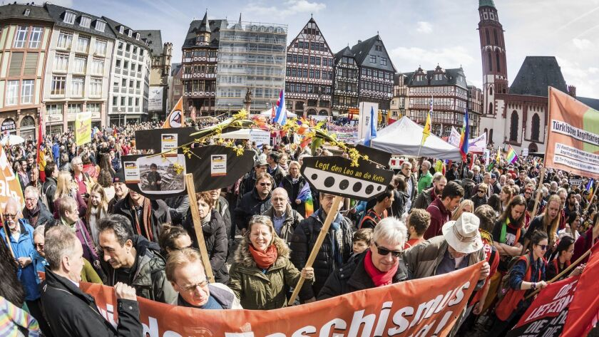 Participants in an Easter peace march gather near the old town hall in Frankfurt, Germany, in April.