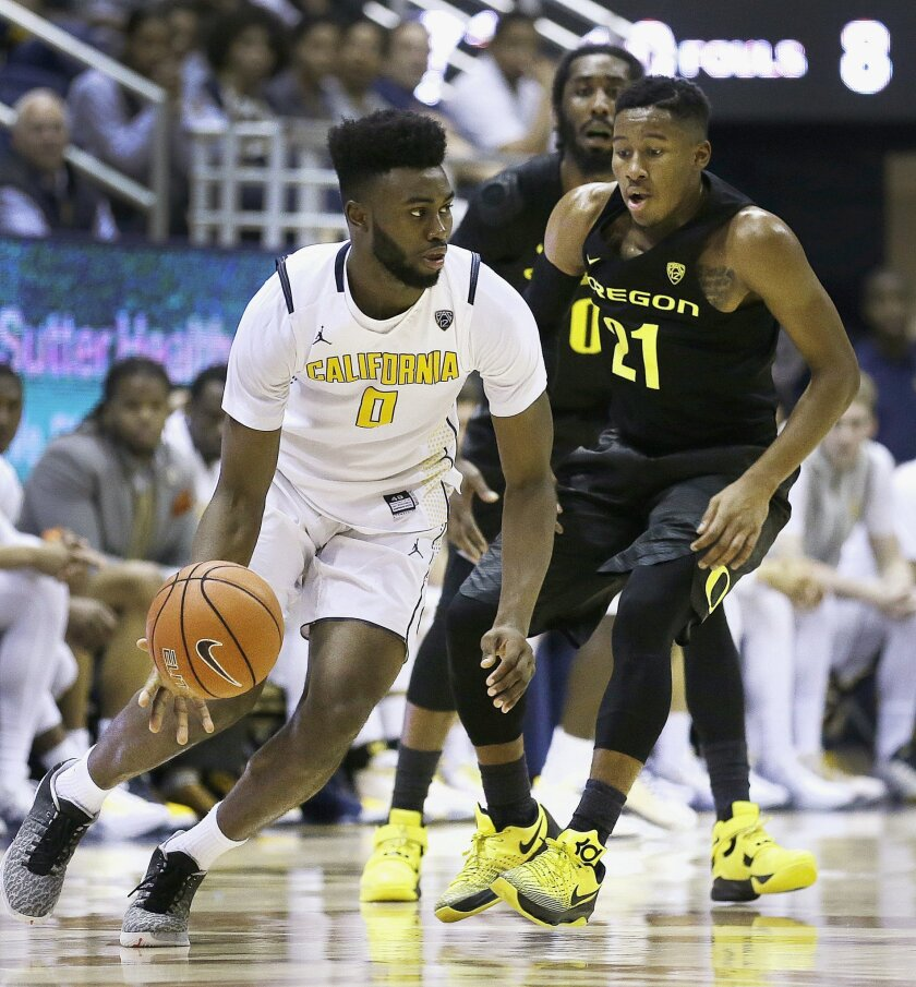 California's Jaylen Brown, left, drives the ball against Oregon's Kendall Small (21) in the second half of an NCAA college basketball game Thursday, Feb. 11, 2016, in Berkeley, Calif. (AP Photo/Ben Margot)