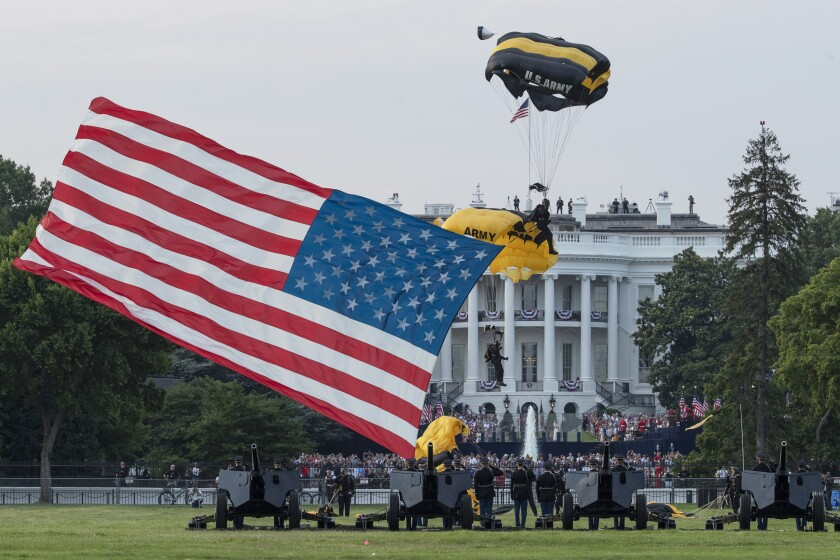 The U.S. Army Golden Knights parachute team descends during a July Fourth event on the South Lawn of the White House.