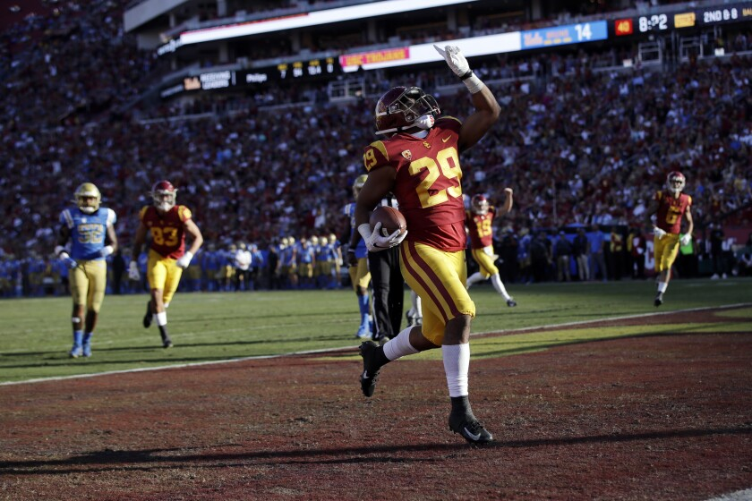 USC running back Vavae Malepeai celebrates as he scores a touchdown against UCLA.