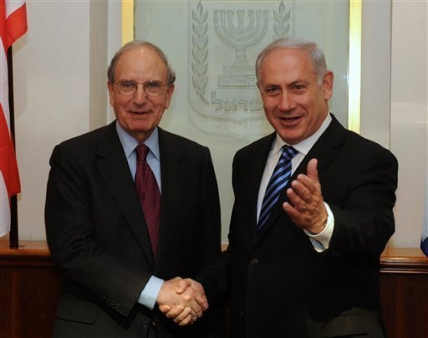 In this photo released by the Israeli Government Press Office, Israel's Prime Minister Benjamin Netanyahu, right, shakes hand with U.S. Mideast envoy George Mitchell during their meeting in Jerusalem, Sunday, March 7, 2010. A skeptical Palestinian leadership agreed Sunday to begin U.S.-mediated pea