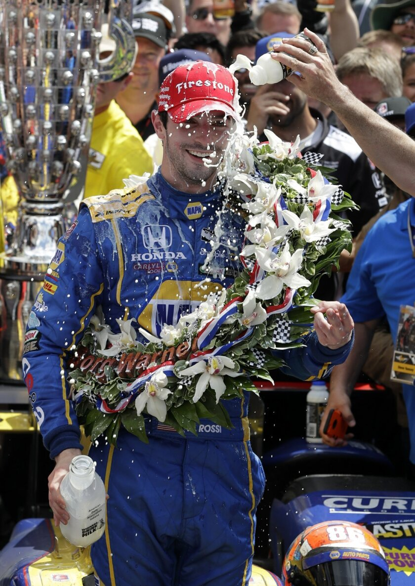 Alexander Rossi celebrates after winning the 100th running of the Indianapolis 500 auto race at Indianapolis Motor Speedway in Indianapolis, Sunday, May 29, 2016. (AP Photo/Darron Cummings)