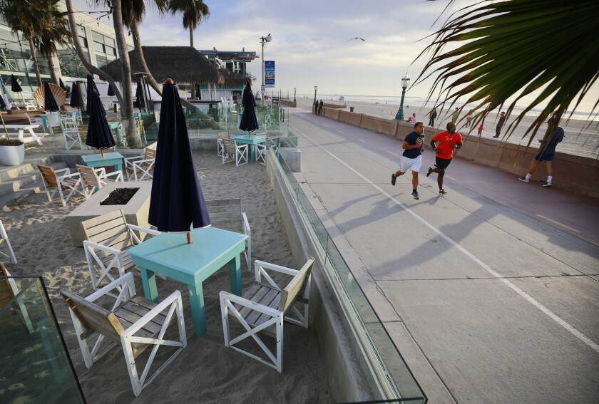 Tables sit empty at the Beach House Grill in Mission Beach on Monday, Dec. 7, 2020.