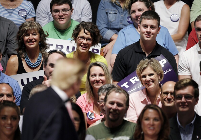 A crowd listens as Republican presidential candidate Donald Trump speaks at a rally and picnic in Oskaloosa, Iowa, in late July.