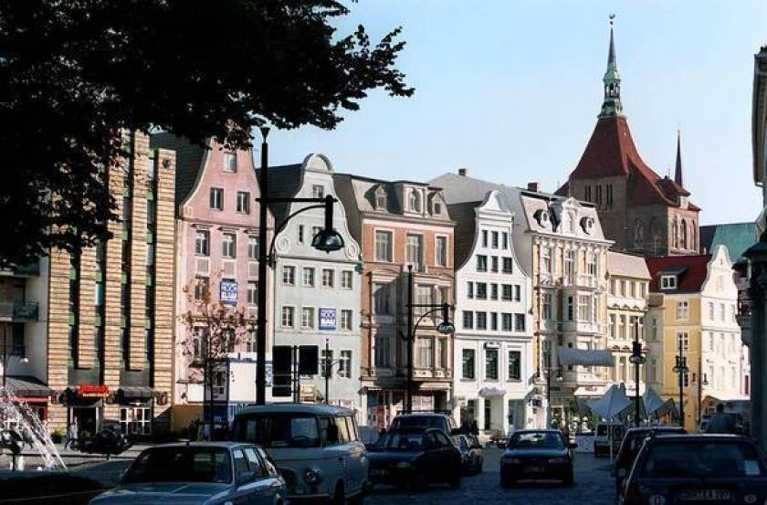 Old Town Rostock's restored buildings bear testimony to Germany's post-unification investment in the eastern city. Many residents of the former East Germany who moved to the west after reunification are starting to move back.