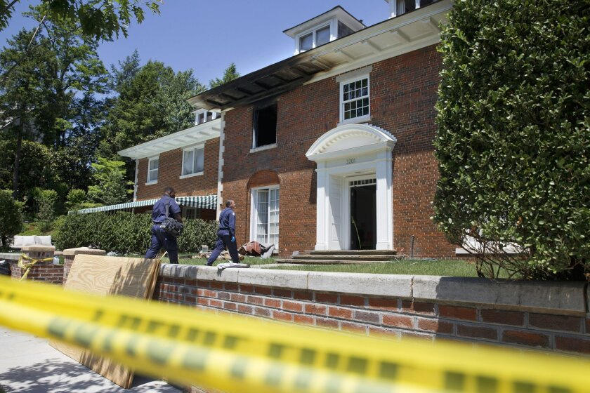 FILE - In this May 22, 2015 file photo, police continue working at a fire-damaged multimillion-dollar home in northwest Washington home where 46-year-old Savvas Savopoulos, his 47-year-old wife, Amy Savopoulos, the couple's 10-year-old son Philip, and housekeeper Veralicia Figueroa were found dead