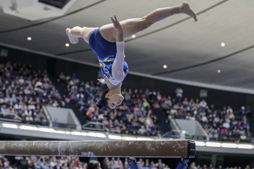 UCLA's Kyla Ross competes on the balance beam at the Collegiate Challenge gymnastics meet Saturday night in Anaheim. Ross won the all-around title.