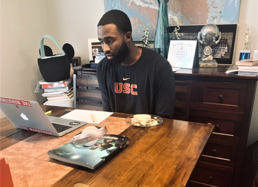 Abdul-Malik McClain studies at home.