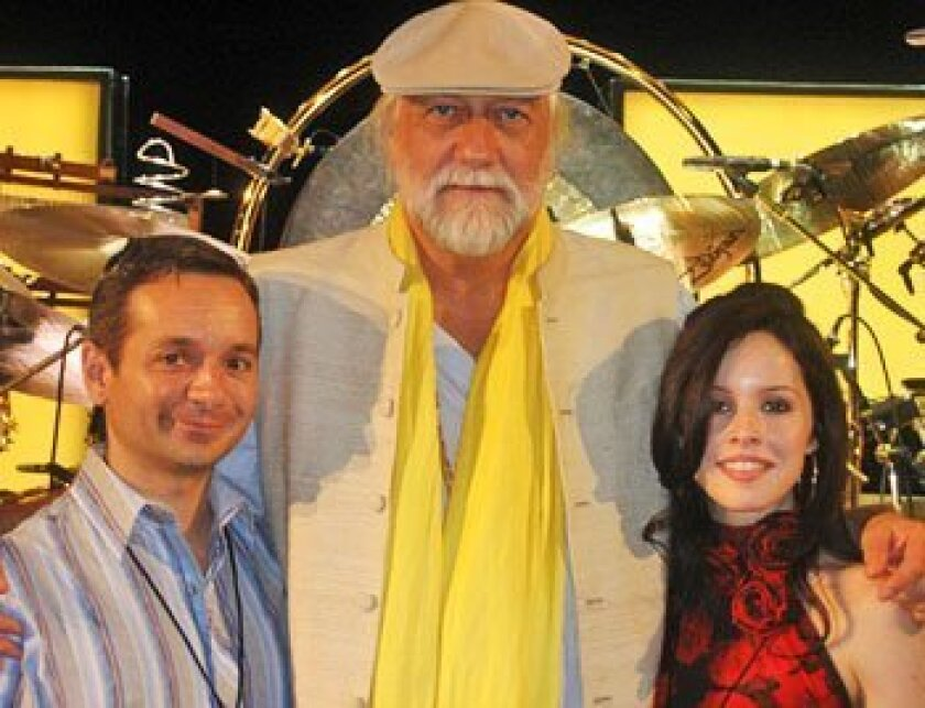 Rock drummer Mick Fleetwood was flanked by VIP-ticket holders Brian Thorp and Patricia Urrutia in Houston on May 2. (Cory O'Donnell)