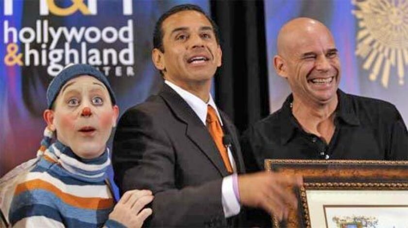 IT'S OFFICIAL: Mayor Antonio Villaraigosa, flanked by Cirque du Soleil founder Guy Laliberte, right, and a character known as The Innocent, announces a 10-year Kodak Theatre deal on Monday.