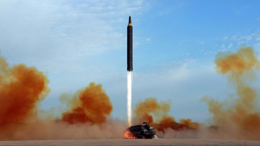 This undated file photo distributed by the North Korean government shows what was said to be the test launch of an intermediate-range Hwasong-12 in North Korea.
